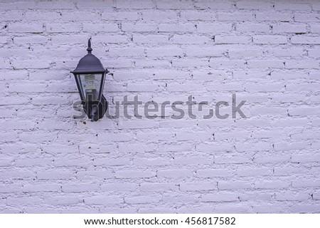 lantern on the white wall - stock photo