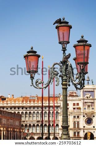 Lantern over Clock Tower in Venice. Italy - stock photo