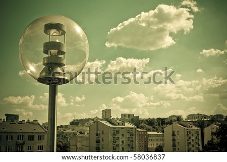 Lantern. Sky with clouds and sun over the Warsaw. View from The University of Warsaw Library's roof. Retro style. - stock photo