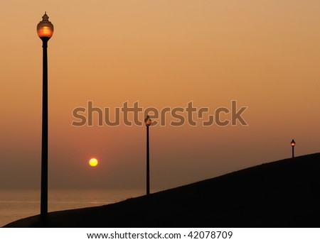 Lanterns by Water at Sunrise