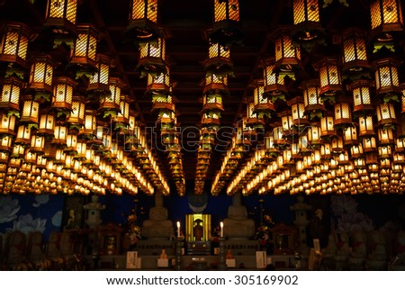 Lanterns hanging on buddhistic temple roof on Miyajima, Japan - stock photo