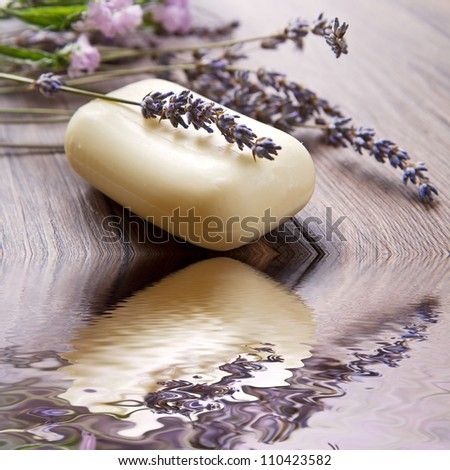 lanvander soap with flower on wooden background - stock photo