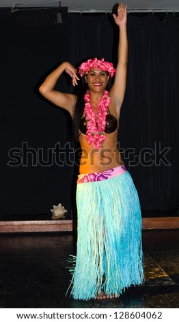 LANZAROTE, CANARY ISLANDS - MARCH 23: Cultural performance of Hawaiian traditional dressed dancer on Barcelo hotel stage on March 23, 2012 on Lanzarote - Canary Islands.