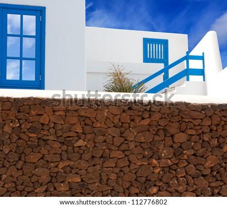 Lanzarote Playa Blanca white house and volcanic masonry in canary Islands [Photo illustration] - stock photo