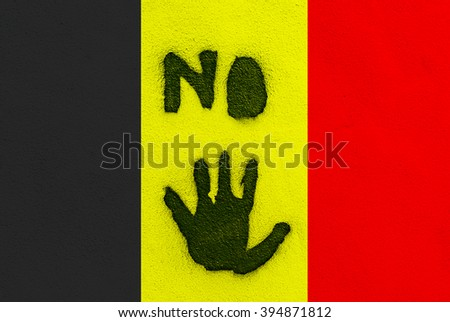 LANZAROTE, SPAIN - Mar 22, 2016: Black NO letters on Belgian flag Black painted NO letters and hand sign, image for protest, solidarity, support for people in Brussels after terror attack - stock photo