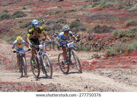 "LANZAROTE, SPAIN - MAY 03: Ayoze Grimon 106, Miguel Angel 171, Guilelermo Rivero  in action at Adventure mountain bike marathon ""Ultrabike Santa Rosa"" May 03, 2015. Lanzarote, Canaries islands, Spain. - stock photo"