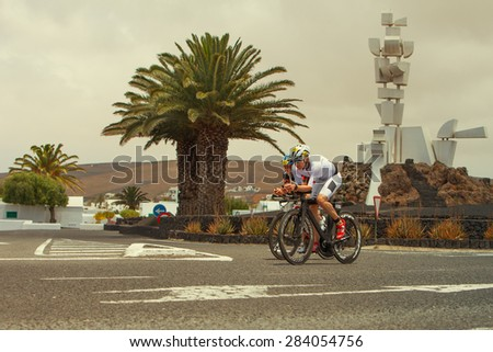 LANZAROTE, SPAIN - MAY 23: Dennis Steffensen of Denmark and Daniel Puerta Morante of Spain in ironman Triathlon 2015 Event May 23 2015, in Lanzarote, Spain. - stock photo