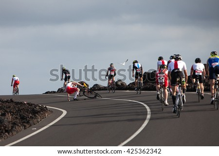 LANZAROTE, SPAIN - MAY 21: Sportsman fell off a bike during the IRONMAN LANZAROTE triathlon on May 21, 2016 in Tamanfaya, Lanzarote, Las Palmas, Canary Islands, Spain - stock photo