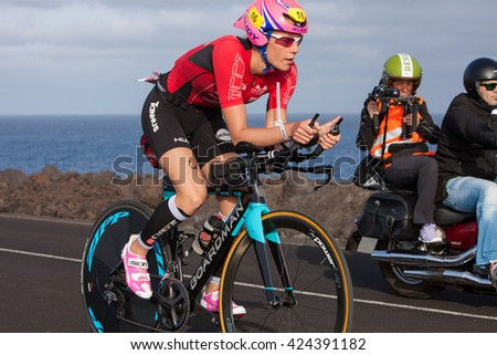 LANZAROTE, SPAIN - MAY 21: Sportsman Lucy Charles (16, GBR)rides a bike during the IRONMAN LANZAROTE triathlon on May 21, 2016 in Tamanfaya, Lanzarote, Las Palmas, Canary Islands, Spain - stock photo