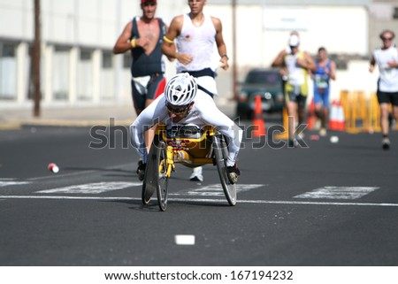 LANZAROTE , SPAIN - NOVEMBER 29: Disabled athlete in a sport wheelchair during 2009 Lanzarote marathon on November 29, 2009 in Lanzarote, Spain.  - stock photo