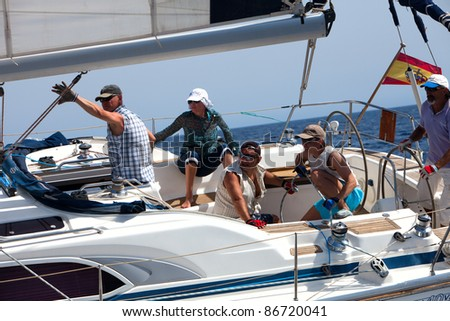 LANZAROTE, SPAIN - OCT. 11: Crew of the yacht number 3 during the race  on Russian BOSS Regatta,  Oct.  11 2011, Canary islands, Spain - stock photo