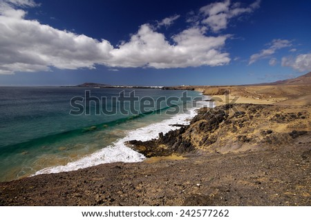 Lanzarote, Spain - View of a beautiful bay and beach at the Playas de Papagayo, Lanzarote, Canary Islands, Spain. - stock photo