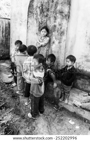 LAO CHAI VILLAGE, VIETNAM - SEP 22, 2014: Unidentified Hmong children play on a break in a local primary school. Hmong is on of the minority eethnic group in Vietnam
