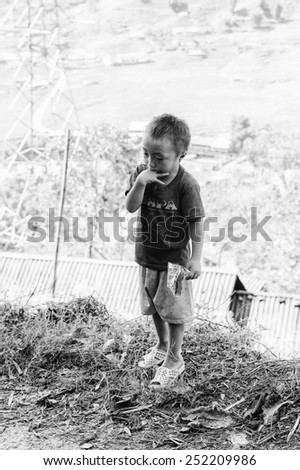 LAO CHAI VILLAGE, VIETNAM - SEP 22, 2014: Unidentified Hmong little boy in a village Lao Chai in Vietnam. Hmong is on of the minority eethnic group in Vietnam - stock photo