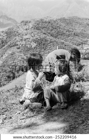 LAO CHAI VILLAGE, VIETNAM - SEP 22, 2014: Unidentified Hmong little girls on a mountain in a village Lao Chai in Vietnam. Hmong is on of the minority eethnic group in Vietnam