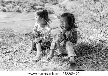LAO CHAI VILLAGE, VIETNAM - SEP 22, 2014: Unidentified Hmong little girls on a mountain in a village Lao Chai in Vietnam. Hmong is on of the minority eethnic group in Vietnam - stock photo