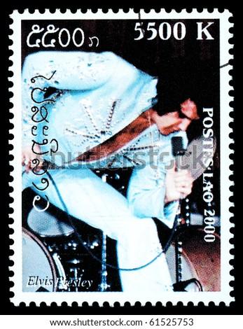 LAOS - CIRCA 2000: A postage stamp printed in Laos showing Elvis Presley; circa 2000 - stock photo
