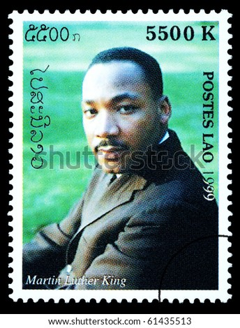 LAOS - CIRCA 1999: A postage stamp printed in Laos showing Martin Luther King, circa 1999 - stock photo