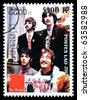 LAOS - CIRCA 2000: A postage stamp printed in Laos showing The Beatles, circa 2000 - stock
