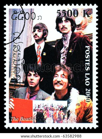 LAOS - CIRCA 2000: A postage stamp printed in Laos showing The Beatles, circa 2000 - stock photo