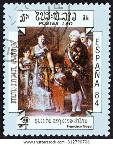 "LAOS - CIRCA 1984: A stamp printed in Laos from the ""International Stamp Exhibition Espana '84, Madrid, Spain "" issue shows The Family of Charles IV (Francisco Goya), circa 1984."