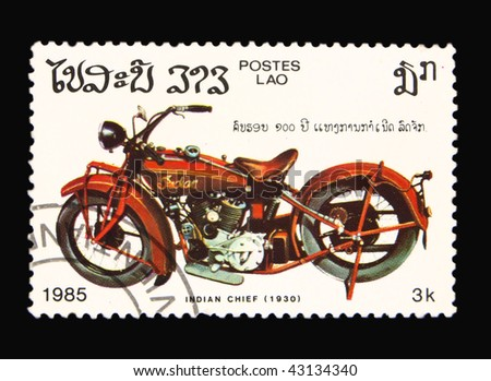 LAOS - CIRCA 1985: A stamp printed in Laos showing vintage motorcycle, circa 1985