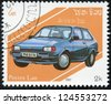 LAOS- CIRCA 1987: A stamp printed in Laos shows Ford Fiesta Mark 2, series is devoted to cars, circa 1987 - stock photo