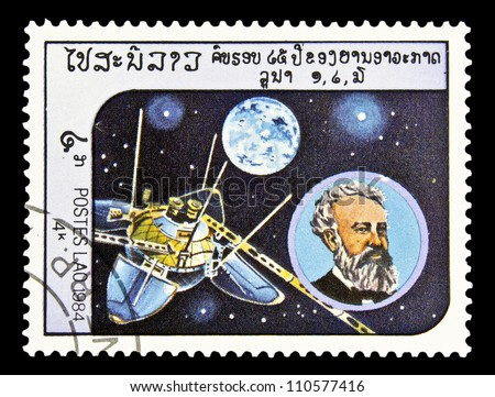 "LAOS - CIRCA 1985: A stamp printed in Laos shows Jules Verne and Luna 13 without inscription, from the series ""Space Exploration"", circa 1985 - stock photo"
