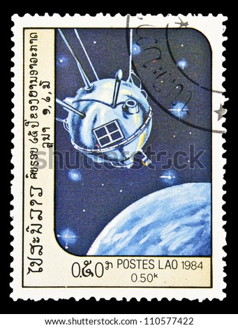 "LAOS- CIRCA 1985: A stamp printed in Laos shows Soviet spacecraft ""Luna 1"" and Moon without inscription, from the series ""Space Exploration"", circa 1985 - stock photo"