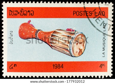 LAOS-CIRCA 1984: A stamp printed in the Laos, depicts a musical instrument (drum), circa 1984  - stock photo