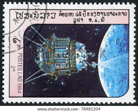 LAOS-CIRCA 1984: A stamp printed in the Laos, depicts the spacecraft Luna 3, circa 1984 - stock photo