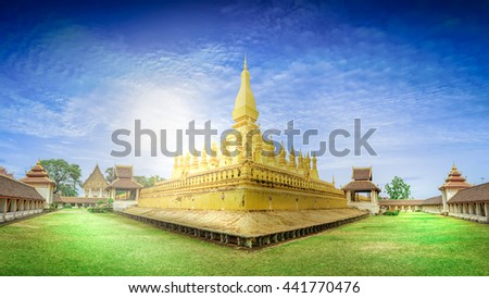 Laos travel landmark, golden pagoda wat Phra That Luang at blue sky in Vientiane, Buddhist temple, Religious architecture and landmarks, Famous tourist destination in Asia. - stock photo