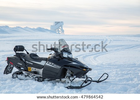 Lapland, Finland - February 20, 2016: Snowmobiles in a winter scenery in Northern Finland.