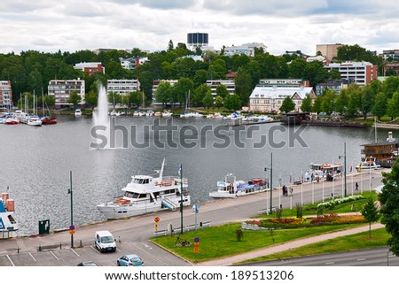 LAPPEENRANTA, FINLAND - JULY 21, 2013 - Pleasure boats are at the pier of the port Lappeenranta - stock photo