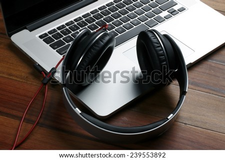 Laptop and Headphones top of the line - stock photo