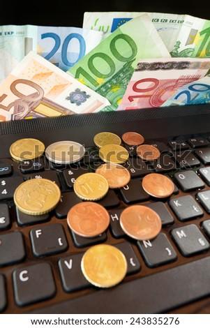 Laptop and money - stock photo