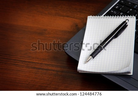 laptop and office on the desktop - stock photo
