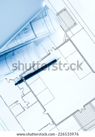 Laptop and pencil on blueprint - stock photo