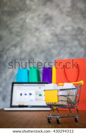 laptop and shopping bags, online shopping concept. - stock photo