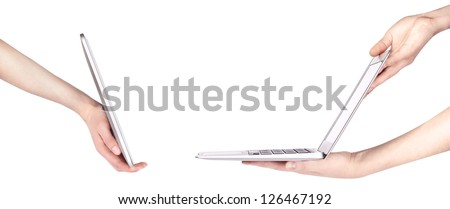 laptop and tablet pc with woman hand isolated on a white background - stock photo