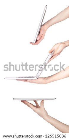 laptop and tablet pc with woman hand set isolated on a white background - stock photo