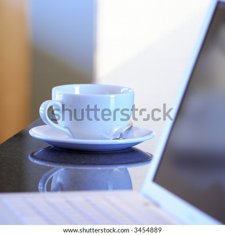 Laptop and tea cup
