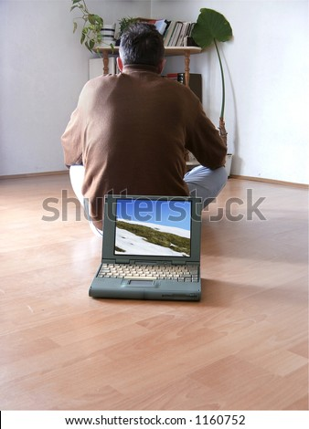 Laptop at floor - stock photo