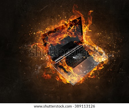Laptop burning with fire