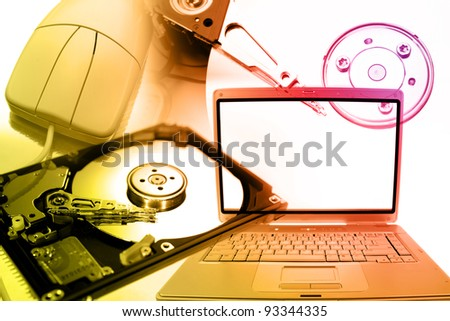 Laptop computer, mouse and hard-drives - stock photo