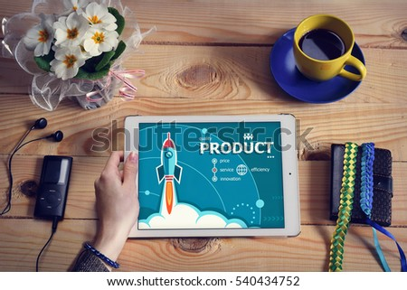 Laptop computer, tablet pc and Product  design concept on wooden office desk with copy space. Design concept background with rocket.