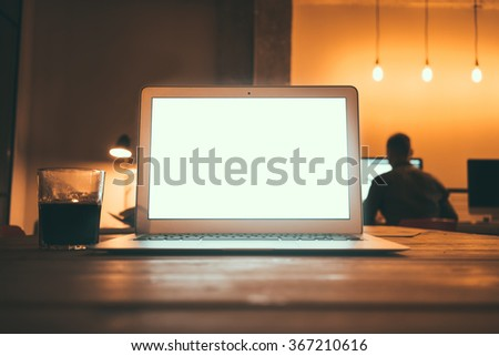 Laptop computer with blank screen on vintage wooden table.Business workplace with open laptop on a modern office background.blank screen for your design,text or content  - stock photo