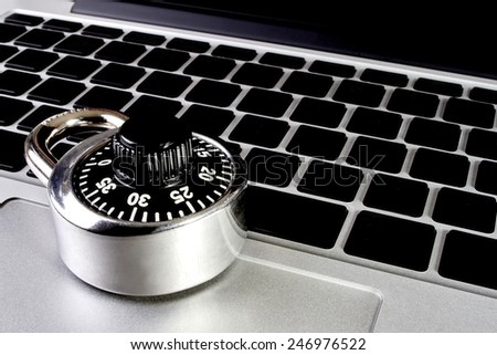 Laptop computer with combination lock - stock photo