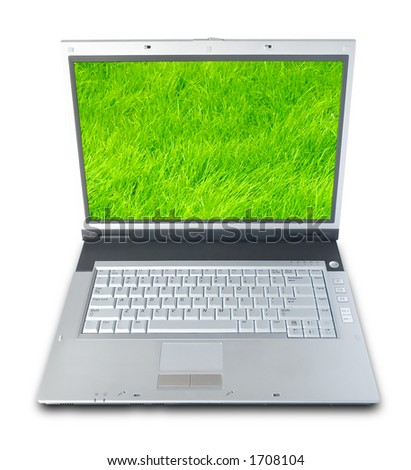 Laptop Computer With Green Grass On Screen (clipping path included) - stock photo