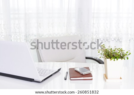 Laptop computer with Smart phone - stock photo